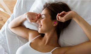 Lady Sleeping with Dreamgirl Soft Foam Earplugs