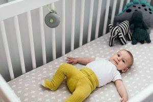 Baby sleeping with white noise machine