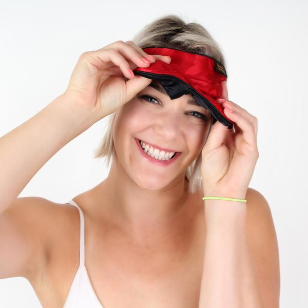 Lady Peaking out from under red silk sleep mask