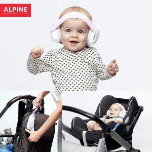 baby wearing white earmuffs