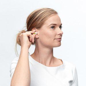 lady inserting earplug