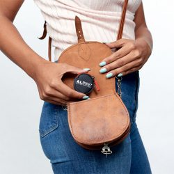 putting party earplugs in handbag