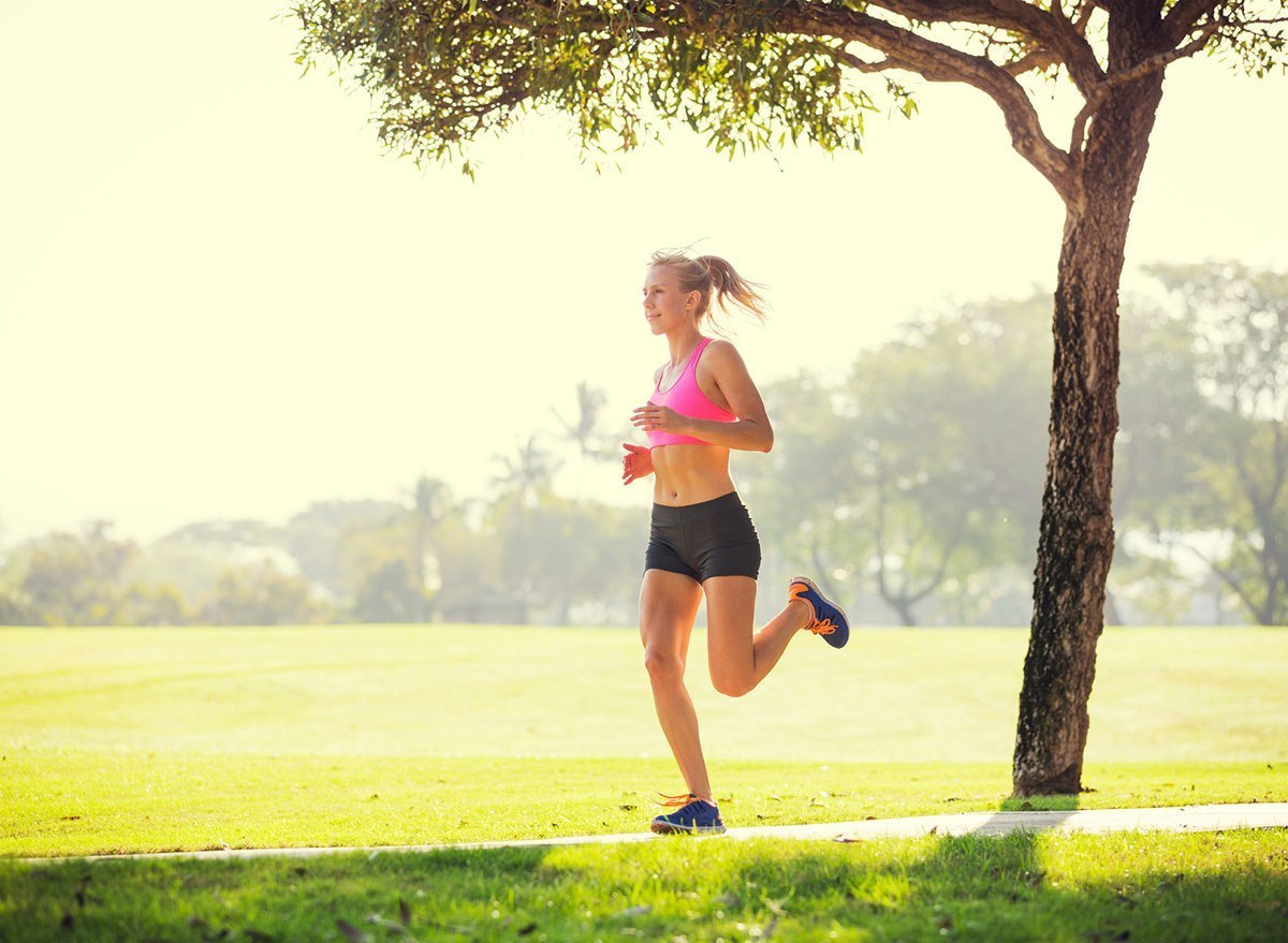 lady running with nasal device for breathing