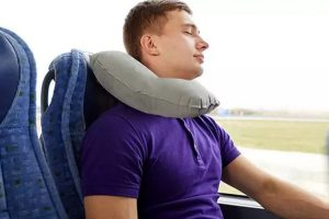 Man Sleeping while travelling with inflatable pillow