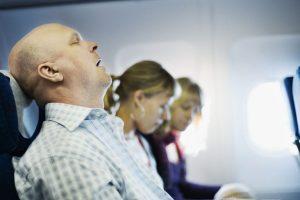 Man Snoring on Plane Travel Pillow