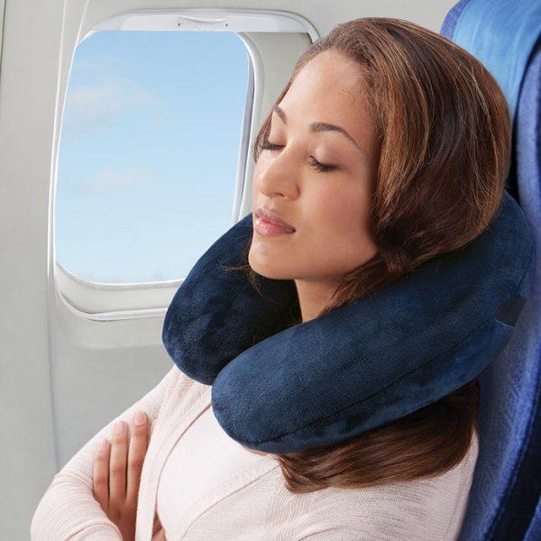 blue plush inflatable travel pillow lady on plane asleep