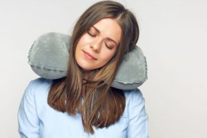Lady Sleeping with Travel Pillow