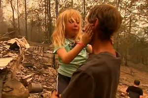 father and daughter crying because of wildfire