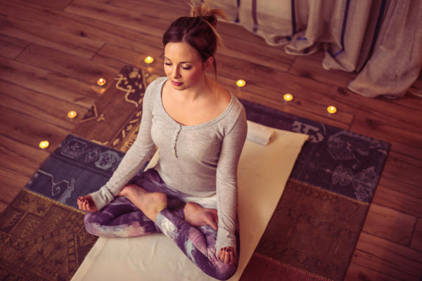 woman doing yoga to relief stress