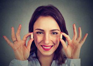 Lady holding earplugs to block noise