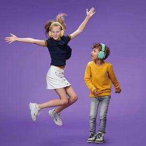 kids jumping wearing earmuffs