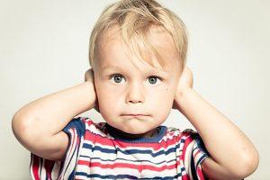 kid blocking ears