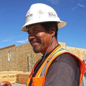 builder wearing plugfones headphones