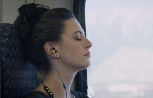lady sleeping plugfones headphones