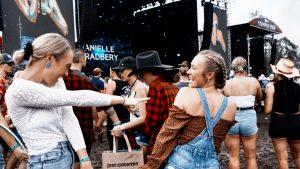 people taking selfies at festival