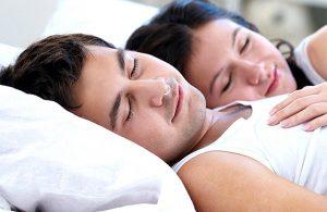 man wearing nasal device to stop snoring