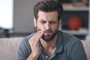 Man with sore jaw