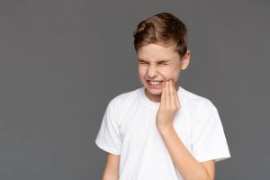 kid with sore mouth from teeth grinding